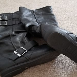 Black  knee high fashion boots.